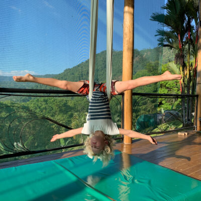 Hugo Doing The Split With Great View In The Background.